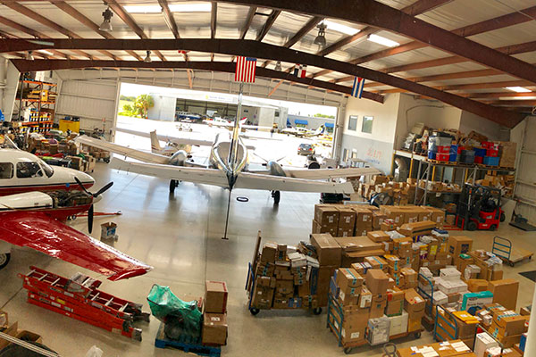 Plane with supplies in garage.