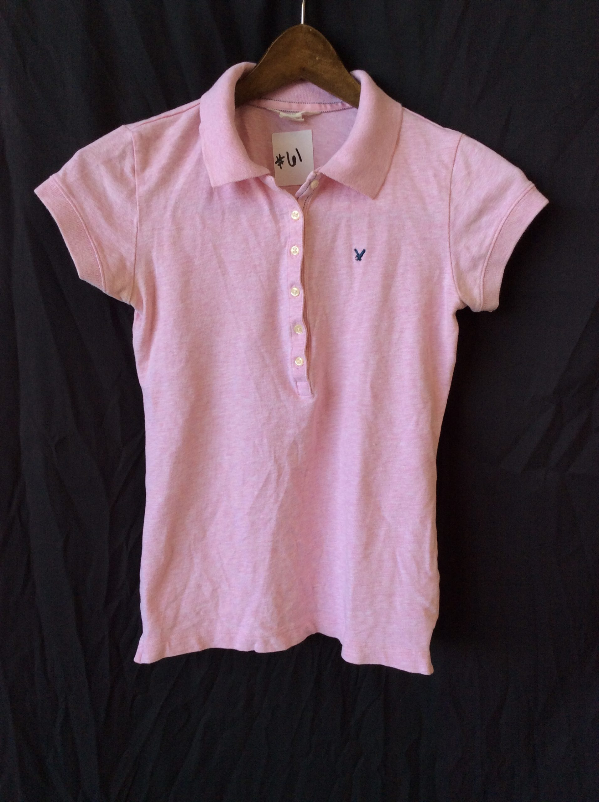 Women's pink polo, size small